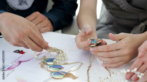 Design team looking at costume jewelry