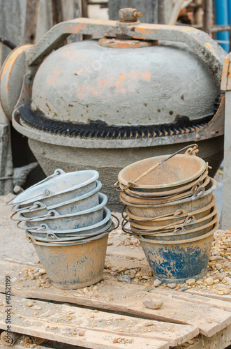 Plastic buckets for transport of cement at construction site