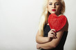 Lovely Beautiful Blond Woman with Red Heart. Show Love Symbol