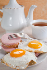 fried eggs, sausage sandwiches