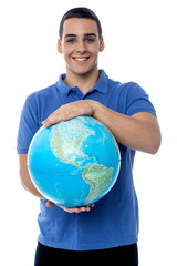 Young man holding globe map