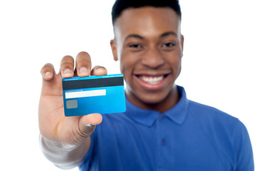 Portrait of young man holding credit card