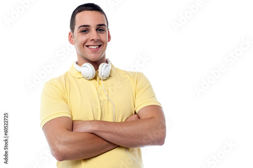 Fashion guy with headphones around his neck