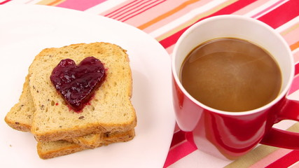 A breakfast scene with a heart of red jam. Be my valentine