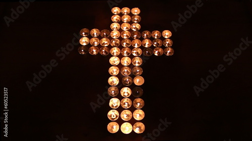 Cross made of candles