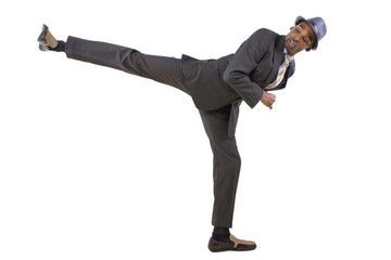 young black businessman doing a karate kick