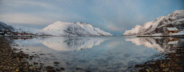 Panoramic view of snowy mountain reflection,Norway