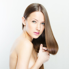 closeup portrait of a beautiful young woman with elegant long sh