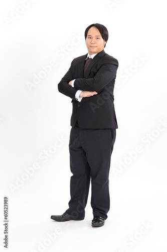 Isolated portrait of fat businessman in black suit
