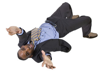 falling young black businessman from top view