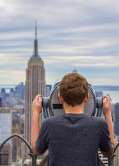 Young boy and New York skyline