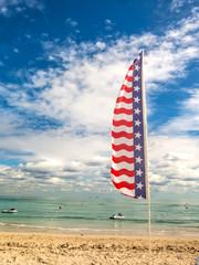 Tropical beach and flag of USA