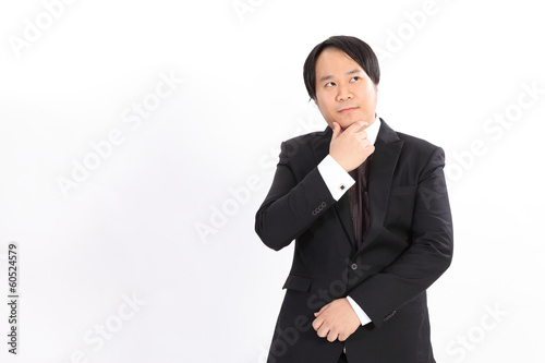 Isolated business man in black suit thinking something