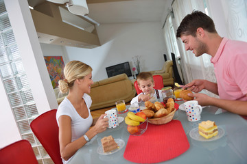 family have healthy breakfast at home