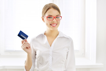 Smiling business woman with credit card