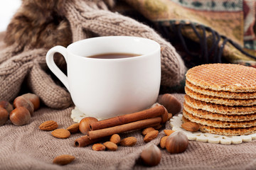 Hot drink, cinnamon and nuts