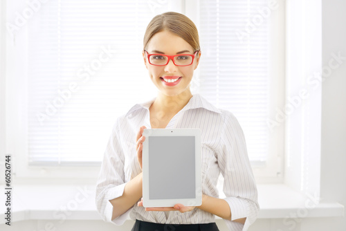 Young business woman with tablet pc