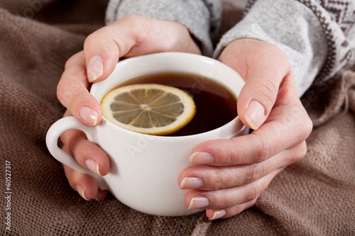 Hands with tea cup