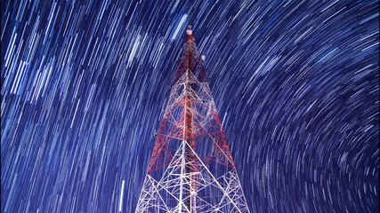 time lapse big communication tower and startrail in night sky