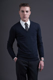 Retro fifties style fashion young man. Wearing dark blue shirt a