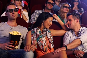 Pretty girl flirting in cinema