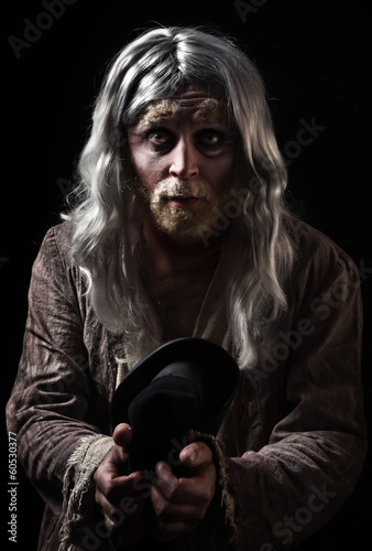 Emotional portrait of the gray-haired tramp