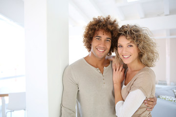 Attractive smiling couple in new home