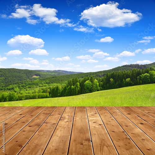 Wooden table in the spring landscape