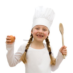 Girl wearing a chef hat and apron