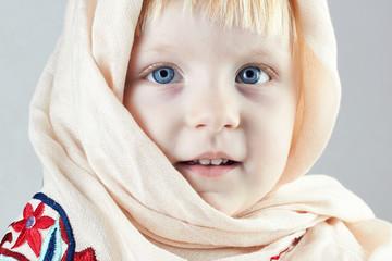 blonde  llittle girl with a shawl
