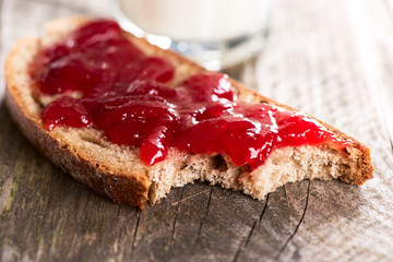 Bread with strawberry jam bited