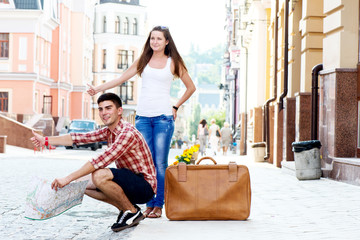 Young couple hitchhiking