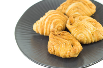 curry puffs in black plate isolated