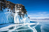 Baikal Lake. Ice and icicles on a rocky island in sunny day