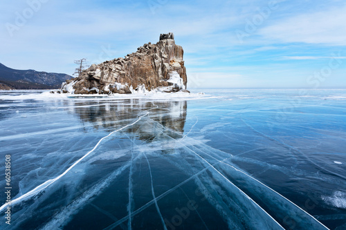 A small rocky island in the frozen winter Baikal Lake