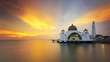 majestic floating mosque during sunset