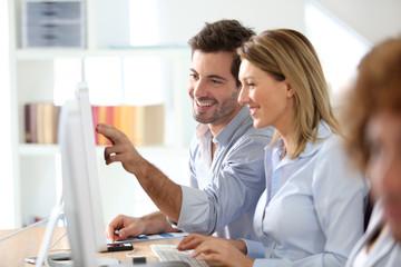 Workteam in office working on desktop computer