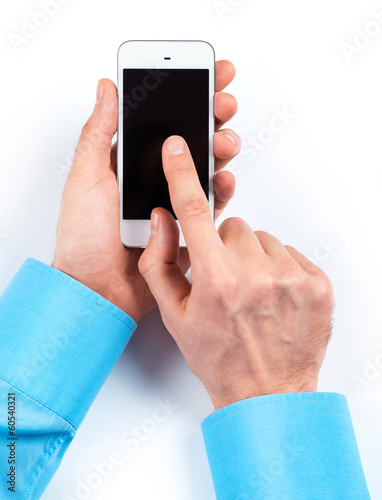 Businessman's hands using smartphone on white