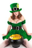 woman dressed as a leprechaun sitting on the floor