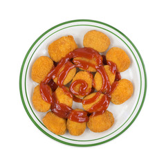 Chicken Nuggets On Green Striped Plate Top With Ketchup