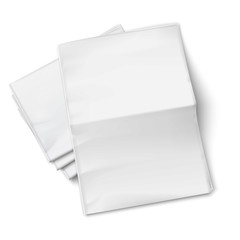 Blank newspapers pile on white background.
