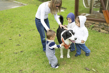 Lovely Family Playing With Pet