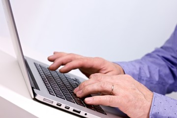 Business man typing on a laptop