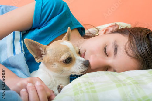 Cute girl sleeping with her dog