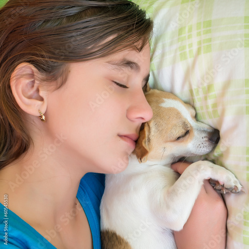 Cute girl sleeping with her small chihuahua dog