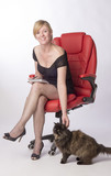 Secretary sitting on office chair with the office cat