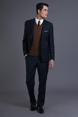 Retro 50s business fashion man with dark grease hair. Wearing da
