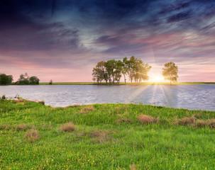 Colorfull summer sunrise ower the river.