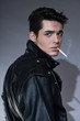 Retro rock and roll 50s fashion man with dark grease hair. Smoki - 60547951