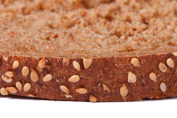brown crust of bread sprinkled with sesame seeds isolated